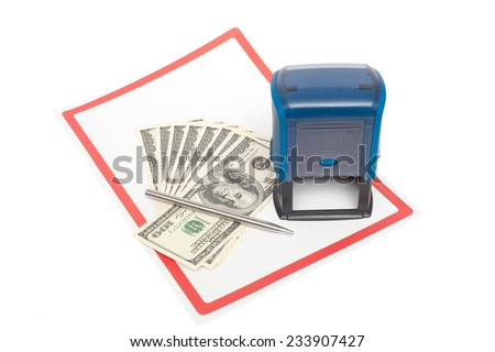 Plastic stamp, US dollars and metal pen over white paper and  - stock photo