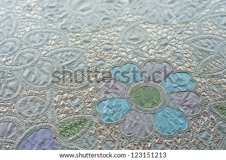 Plastic tablecloth in flower pattern. - stock photo