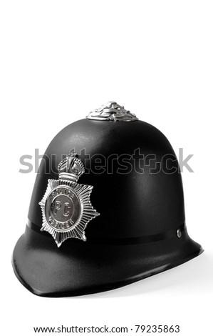 Plastic toy helmet made after a model of metropolitan London police helmet - stock photo