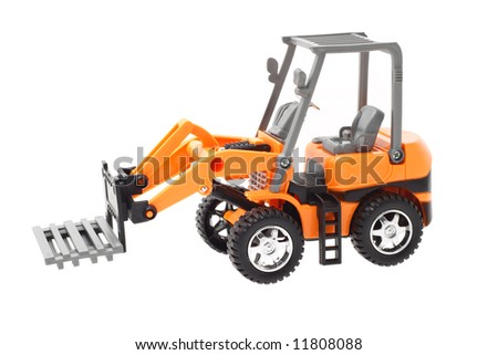 Plastic toy tractor with front end pallet fork attachment - stock photo