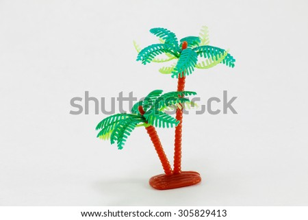 Plastic toy tree on a white background - stock photo