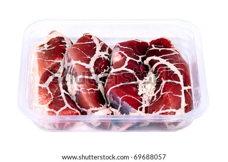 plastic tray with half-finished tasty chilled meat product isolated over white - stock photo