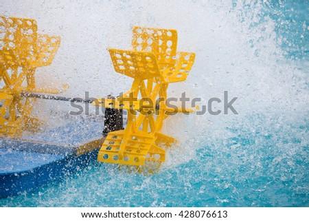 Plastic turbine wheel fill oxygen into water in the pool - stock photo