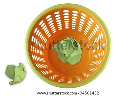 Plastic wastepaper basket with green waste paper. - stock photo