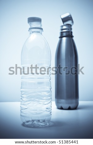 Plastic Water Bottle Compared to Reusable Water Bottle - stock photo