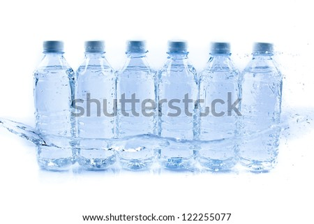 Plastic water bottle with drops - stock photo
