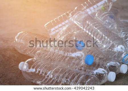 Plastic water bottles on cement floor.To be recycle - stock photo