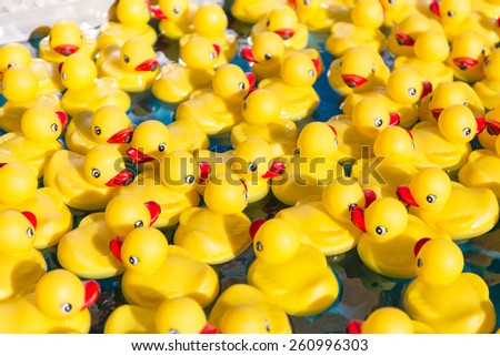 Plastic yellow toy duck in the water - stock photo