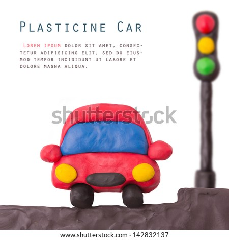 Plasticine car and traffic llight on a white background - stock photo