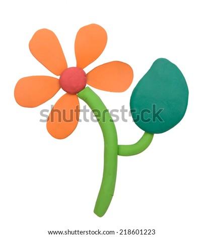 Plasticine clay flower on white background - stock photo