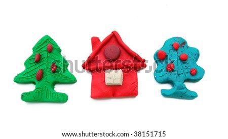 Plasticine house and trees isolated on white background - stock photo