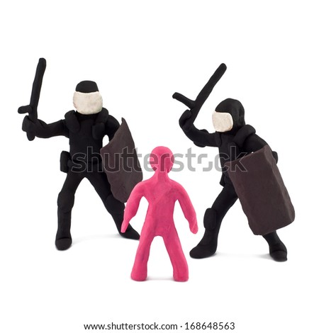 Plasticine police beating of children isolated on white background - stock photo