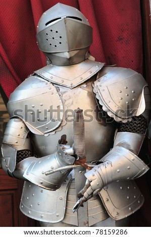 Plate armor shield suit of a knight from the European Late Middle Ages. - stock photo