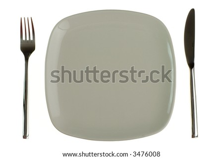 Plate, knife and fork. Isolated on white background. - stock photo