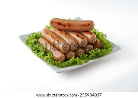 Plate of barbeque sausage on with background - stock photo