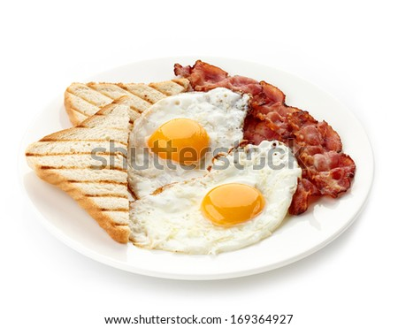Plate of breakfast with fried eggs, bacon and toasts isolated on white background - stock photo