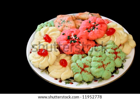 Plate of Christmas Cookies isolated on black. - stock photo