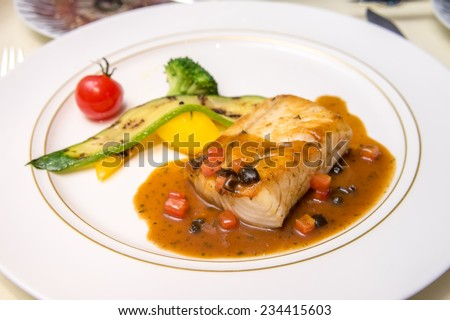 Plate of cod fish fillet steak - stock photo