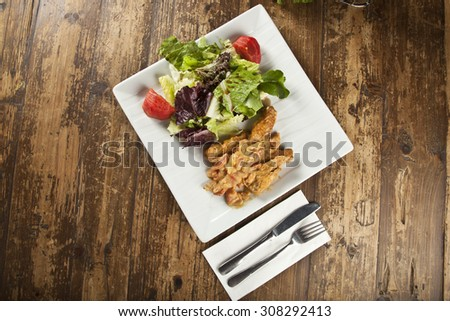 Plate of Cod or Pollack Fish Fillet Stewed in Tomato and Thyme Sauce Garnished - stock photo