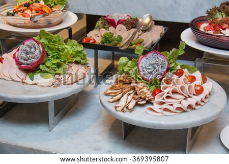 Plate of Cold cuts with chickenen and ham. - stock photo