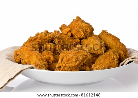 Plate of crispy fried chicken wings and drumsticks. - stock photo