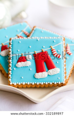 Plate of decorated Christmas cookies - stock photo