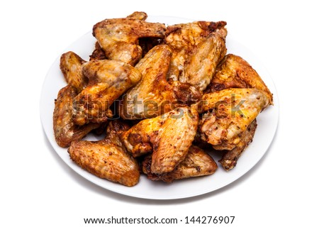 Plate of delicious barbecue chicken wings - stock photo