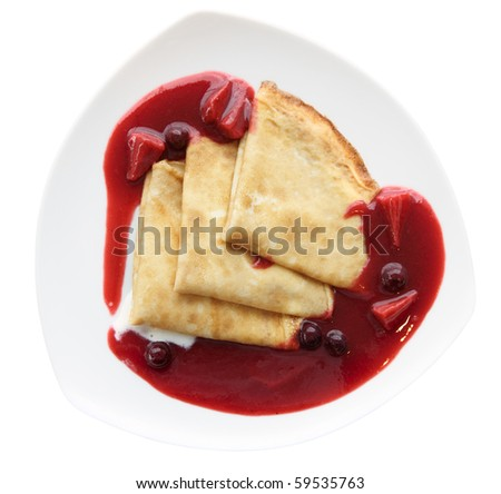 Plate of delicious pancakes with berry jam isolated on white - stock photo