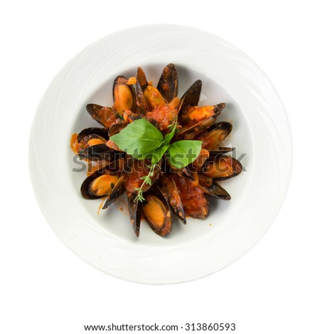 Plate of fresh mussels with tomato sauce isolated on white background - stock photo
