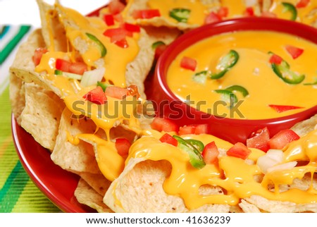 Plate of freshly made hot and spicy nachos - stock photo
