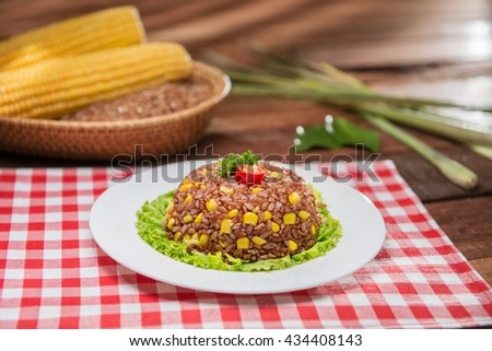 Plate of fried rice on the table in restaurant - stock photo