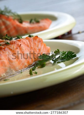 Plate of Fried Salmon fillet and spices - stock photo
