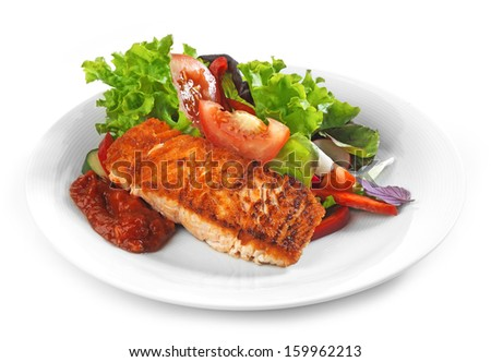 Plate of Grilled salmon fillet and vegetable salad - stock photo