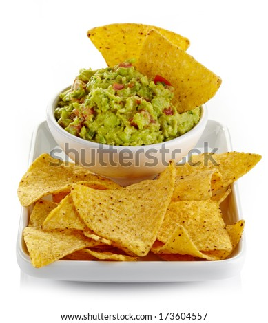 Plate of guacamole dip and nachos isolated on white background - stock photo