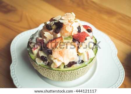 Plate of healthy fresh fruit salad on wooden table, Healthy breakfast, Weight loss concept, Diet - stock photo