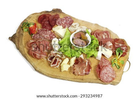 Plate of mixed meats and cheeses - stock photo