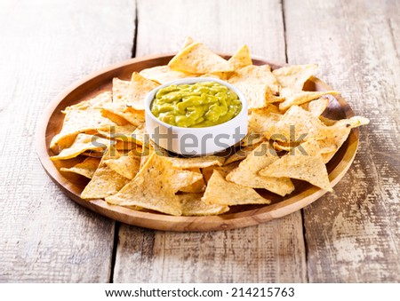 plate of nachos with guacamole - stock photo