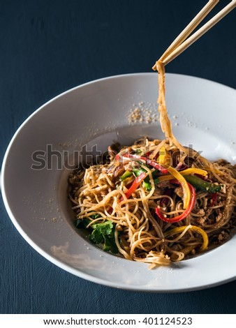 Plate of pasta with souce and pepper - stock photo