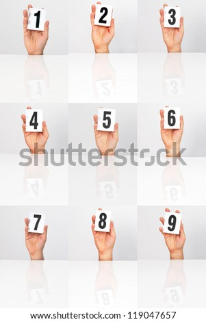 plate of points kept in the hands - stock photo