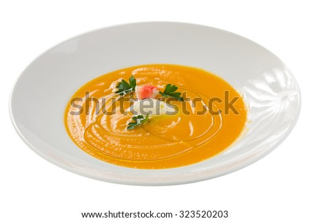 Plate of pumpkin cream soup with crab isolated on white background - stock photo