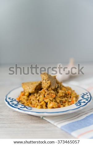 Plate of rice and meat national dish pilau - stock photo