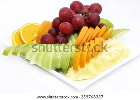 plate of ripe fruit on a white background - stock photo