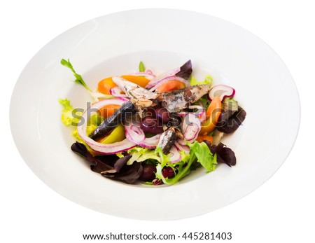 Plate of salad with vegetables and pilchards isolated over white - stock photo