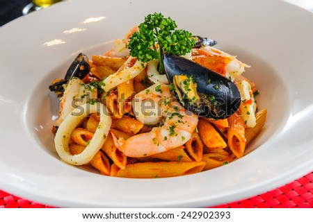 Plate of sea food pasta. - stock photo