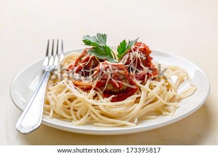 Plate of Spaghetti with Meatballs in Tomato Marinara Sauce - stock photo