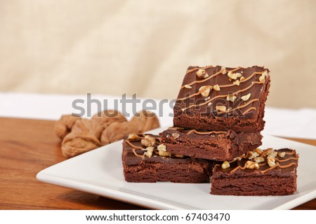 Plate of walnut turtle brownies with room for copy - stock photo