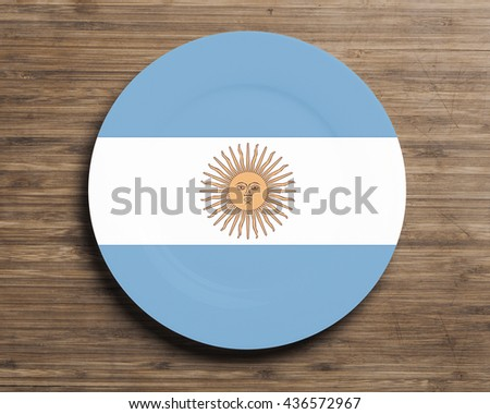 Plate on table with overlay flag of  Argentina - stock photo