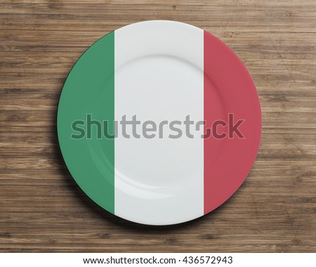 Plate on table with overlay flag of Italy  - stock photo