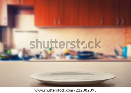 Plate on the kitchen table - stock photo