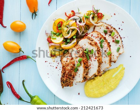 Plate with baked turkey, veggies salad and sauce. Shallow dof. - stock photo